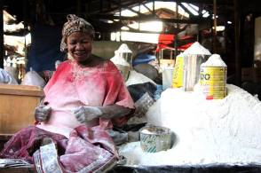 There was no music, but she was dancing in her pile of cassava flour.